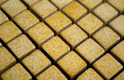 Yellow mosaic. Yellow  tile mosaic Stock Images