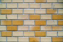 Yellow mosaic tiles wall in toilet. Background and texture royalty free stock photo
