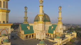 Yellow Mosque Habbul Wathan Mosque in Indonesia, Aerial drone view Mosque Sunny day, blue sky, sunset stock video footage
