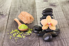 Yellow Moth orchid, bath salt and black stones close-up Stock Photos