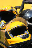 Yellow motobike helmet Stock Images