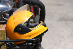 Yellow motobike helmet Stock Photography