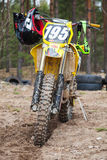 Yellow motocross bike stands on the dirty road Stock Photography
