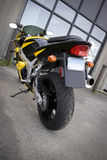 Yellow Motorcycle. The rear view of a modern yellow motorcycle royalty free stock images