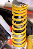Yellow motorcycle shock absorbers. Royalty Free Stock Photos