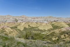 Yellow Mounds of the Badlands. This is a Spring picture of the Yellow Mounds of the Badlands located inBadlandsNational Park in Pennington County in South Dakota Royalty Free Stock Photos