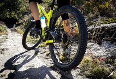 Yellow Mountain Bike and Riders Feet royalty free stock photography