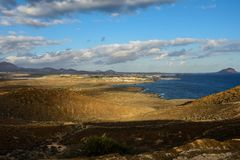 The Yellow Mountain on the ocean shore in Costa del Silencio, Tenerife. Stock Images