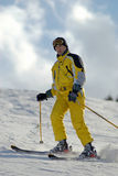 Yellow mountain skier Stock Photo