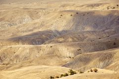 Yellow mountain terrain with shadow from the clouds stock photos