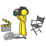 Yellow movie cameraman. An illustrated of a yellow movie cameraman surrounded with items related to movies making including a clapperboard, reels of film and a Royalty Free Stock Photos