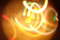 Yellow moving lights background with hard vignette Royalty Free Stock Photo
