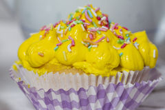 Yellow muffin. Yellow cream muffin details Royalty Free Stock Images