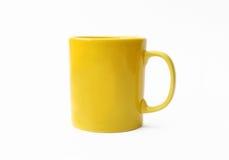 Yellow mug. Isolated on white background Royalty Free Stock Photo