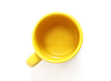 Yellow mug. Isolated on white background, the top view Royalty Free Stock Photo