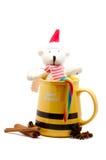 Yellow mug with cinnamon and bear Stock Image