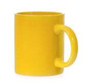 Yellow mug. Empty blank for coffee or tea isolated on white background Royalty Free Stock Photos