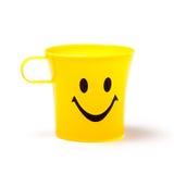 Yellow mug smile isolated on white background Stock Photography