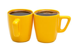 Yellow mugs of coffee Stock Photography