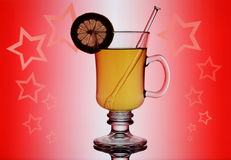 Yellow mulled wine on red background with stars Stock Photography