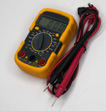Yellow multimeter with green display Royalty Free Stock Photo