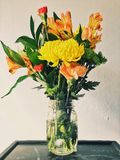 Yellow Mums, Orange Peruvian Lilies, and Carnation Flower Arrangement Stock Images