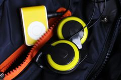 Yellow music player and beautiful overhead headphones. Lux Stock Photo