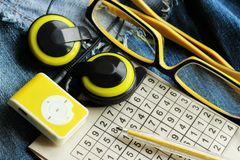 Yellow music player and beautiful overhead headphones. Lux Royalty Free Stock Photos