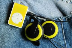 Yellow music player and beautiful overhead headphones. Lux Royalty Free Stock Image