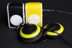 Yellow music player and beautiful overhead headphones. Lux Stock Photography