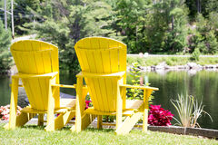 Yellow Muskoka Chairs With A View Royalty Free Stock Photos