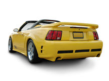 Yellow Mustang Convertible. A rear view of a Mustang Convertible, isolated on white background with clipping path. See my portfolio for more automotive images royalty free stock photos