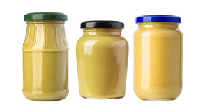 A yellow mustard bottle. Against a white background with clipping path Stock Photos