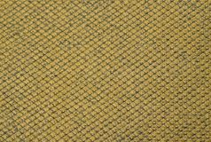 Yellow mustard colored fabric swatch samples texture unprinted suiting fabric from above .Cloth texture. Yellow mustard colored fabric swatch samples texture stock image
