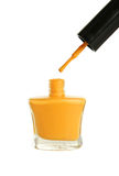 Yellow nail polish bottle isolated on white Royalty Free Stock Photography