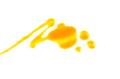 Yellow nail polish drops sample, isolated on white Royalty Free Stock Image