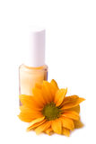 Yellow nail polish and flower Royalty Free Stock Image