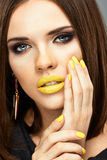 Yellow nails and lips. Beauty woman Royalty Free Stock Images