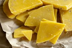 Yellow natural beeswax. For natural beauty and D.I.Y. preoject royalty free stock photography