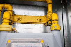 Yellow natural gas pipe connections in the box. Close up shot stock photography