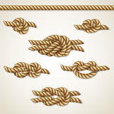 Yellow nautical rope knots set over beige background Stock Photography