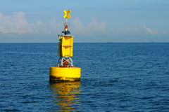 Yellow navigational buoy Royalty Free Stock Image