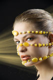 Yellow necklace around face Stock Images