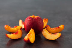 Yellow nectarine peach on grungy background Royalty Free Stock Photos
