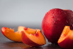 Yellow nectarine peach with water drops. Stock Photography