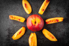 Yellow nectarine peach whole and slices Stock Photography