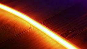 Yellow neon light on wood, abstract motion background Stock Image