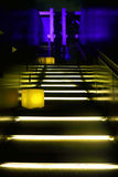 Yellow neon lit staircase Stock Photography