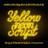 Yellow neon script alphabet font. Handwriting neon uppercase and lowercase letters and numbers. Hand drawn vector typeface for your headers or any typography royalty free illustration
