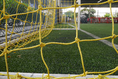 Yellow net of soccer goal Stock Image